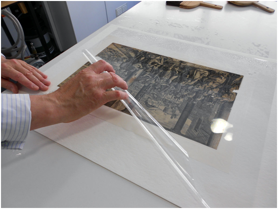 the object was then turned over and the Melinex on the recto of the print was removed in the same way.