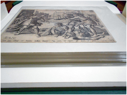 The conserved prints are now sleeved in Secol enclosures, which protects them and allows them to be handled.